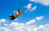 Crazy flying man in clouds — Stock Photo
