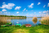 Lake landscape with boats — Stock Photo