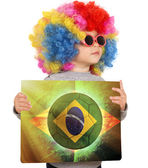 Child with Brazilian soccer flag — Stok fotoğraf