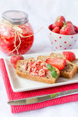 Strawberry butter on the banana bread — Stok fotoğraf