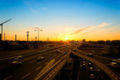 Sunset and highway — Stock Photo