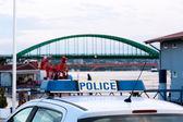Police car near the ships dock — Stock Photo