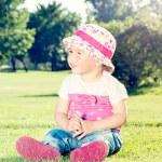 Child sitting on the grass — Stock Photo #47904021