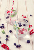 Soda water with berry fruits — Stock Photo