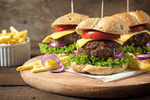 Beef burgers with melted cheese — Stock Photo
