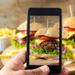 Man shooting with phone burgers — Stock Photo #49223613