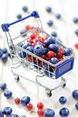 Trolley with blueberry and currant — ストック写真