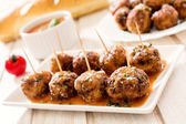 Juicy meatballs in tomato sauce — Stock Photo