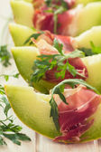 Green mealon and prosciutto — Stock Photo