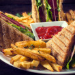 Club sandwiches and french fries — Stock Photo #49947439