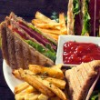 Club sandwiches and french fries — Stock Photo #49949279