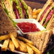 Club sandwiches and french fries — Stock Photo #49949403