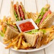 Club sandwiches and french fries — Stock Photo #49949689