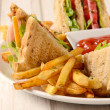 French fries and club sandwiches — Stock Photo #50008717