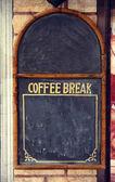 Coffee break chalk board on the wall — Stock Photo