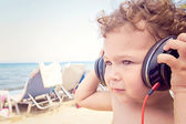 Child holding headphones on head — Foto Stock