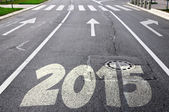 Road to new year 2015 with arrows — Stock Photo