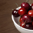 Fresh cherries with wood table 2 — Stock Photo #27825427