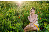 Young Woman relax in poppy field — Stock Photo
