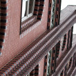Red brick apartment block — Stock Photo #31917523