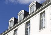 Modern design vertical roof window with black light metal coveri — Stock Photo