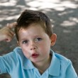 Stock Photo: Little boy scratching his head