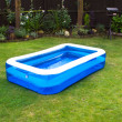 Stock Photo: Inflatable swimming pool in english garden