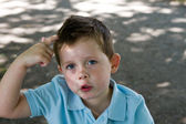 Little boy scratching his head — Stock Photo