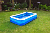 An inflatable swimming pool in an english garden — Stock Photo