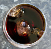 Top view of glass of cola with ice — Stock Photo
