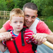 Stock Photo: Father and son on rowing boat