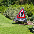 Hedge cutting sign in country garden - Stock Photo