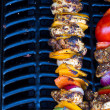 Royalty-Free Stock Photo: Chicken and pepper kebabs slowly cooking on the barbecue