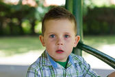 Boy in the park looking out thinking — Foto Stock