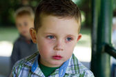 Sad little boy with a runny nose — Stock Photo