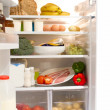 Stock Photo: Full up fridge with open door