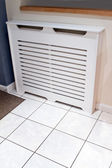 Radiator cabinet cover in a modern kitchen — Stock Photo