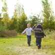 Brothers playing in the summer meadow — Stock Photo #13948327