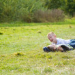 Brothers playing in the summer meadow - Stock Photo