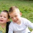 Two brothers smiling in the meadow — Stock Photo #13948471