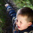 Little boy crying out in the woods - Stock Photo