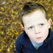 Puzzled looking little boy looking to the left — Stock Photo