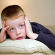 Little boy watching TV in the lounge — Stock Photo #14696469
