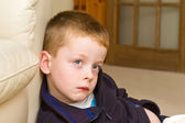 Little boy watching TV in the lounge — Stock Photo