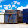 Recycling centre waste bin with cloudy blue sky — Stock Photo #15334069