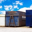 Stock Photo: Recycling centre waste bin with cloudy blue sky