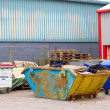 Rubbish and trash in and around a skip — Stock Photo