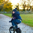 Boy riding his bike through a countryside path — Stock Photo