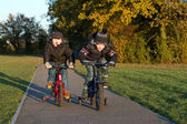 Boys riding their bikes in a country park — Stock Photo