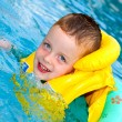 Little boy swimming with life vest on — Stock Photo